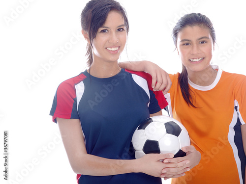 smiling girls with a soccer ball