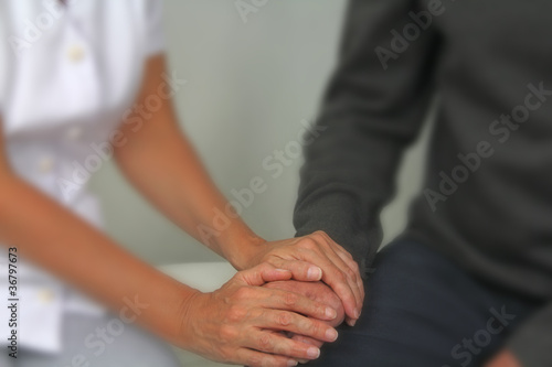 Therapist comforting male patient