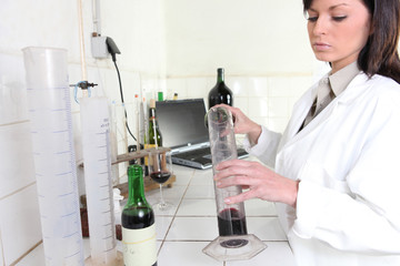 Testing red wine in a laboratory