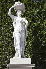 statue in the garden of the schonbrunn palace, vienna, austria