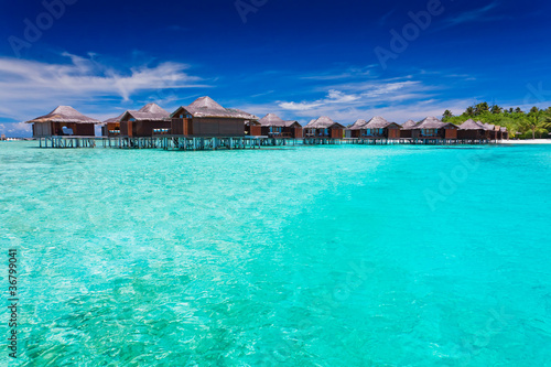 Overwater bungallows in blue lagoon