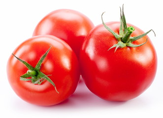 Ripe tomatoes isolated on a white background.