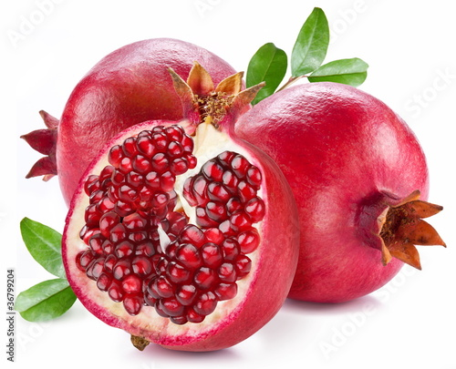 Ripe pomegranates with leaves.