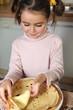 Little girl preparing pancakes