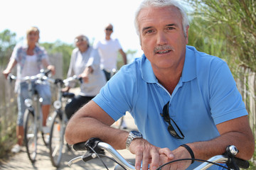 Middle-aged people on bike ride