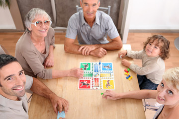 Family playing board games.