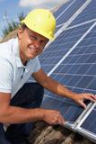 Man installing solar panels