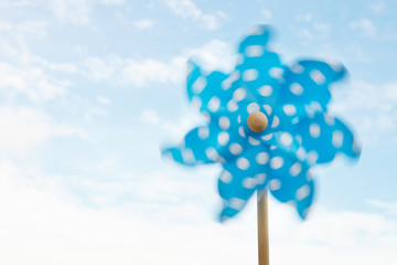Child's plastic windmill turning in wind
