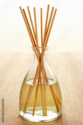 Incense sticks in carafe of water