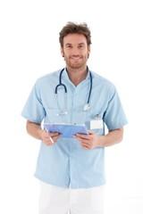 Goodlooking doctor smiling at camera
