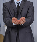 Businessman asking for money. hand symbol