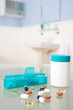 Pills and organiser in bathroom