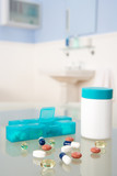 Pills and organiser in bathroom