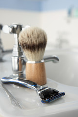 Man's shaving kit in bathroom