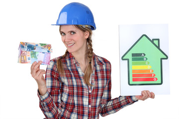 Woman holding money and energy rating card