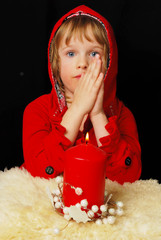 Portrait of young praying girl