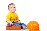 smiling child with hard hat and construction tools