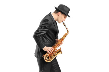 A young man playing on saxophone