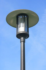 Street lamp with a large screen, blue sky in the background