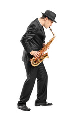 Full length portrait of a young man playing on saxophone