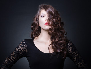Portrait of young woman with wavy hair. Fashion photo