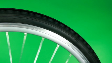 part of bicycle wheel fast rotating on chroma key