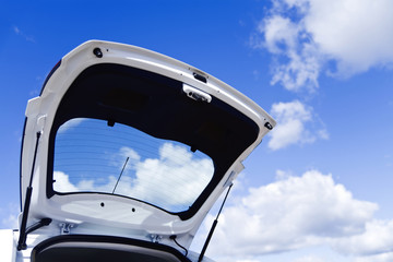 Open luggage carrier of the car against the blue sky