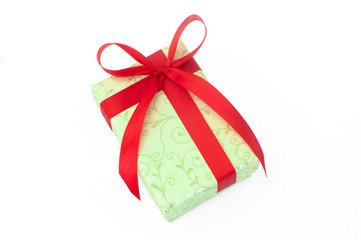 cream gift box with red ribbon