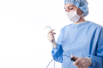 Female doctor or nurse holding a catheter