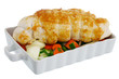 Bound grilled turkey breast with  vegetables on baking pan