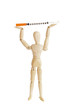 Wooden figure holding medicine injector