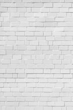 Biały mur z cegły, w pionie