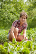 Teenager girl working in  field