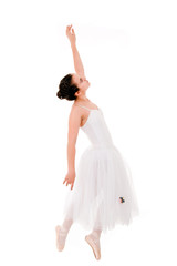 young and beautiful ballet dancer jumping on white background