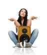 Young beautiful girl in headphones with wooden speaker