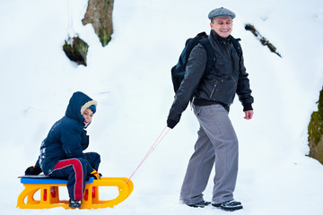 Father and son with a sledge