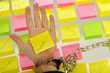 business woman hands holding sticky notes; business concepts