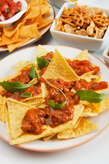 Nachos, corn chips with chili sauce