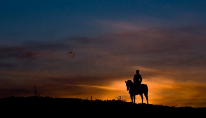 Riding a horse in sunset