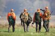 Leinwandbild Motiv Vier Jäger nach der Treibjagd