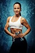 Beautiful athlete woman  with dumbbells.