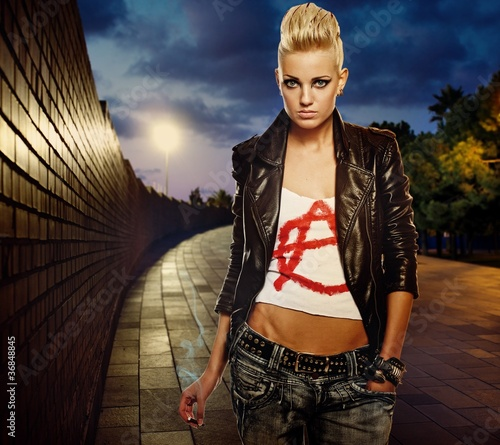 Punk girl with cigarette outdoor