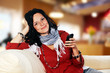 youthful pretty lady with smartphone