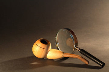 Magnifying Glass And Tobacco Pipe
