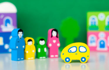 Funny toy car and toy family