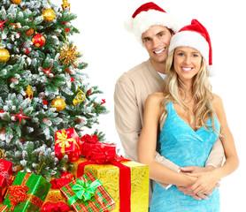 Happy couple near Christmas Tree.