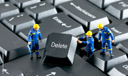 Team of construction workers working on a computer keyboard