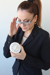 Business woman holds a timer clock