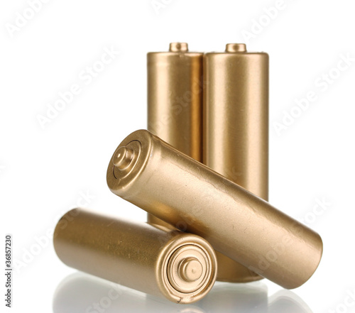 four golden batteries isolated on white