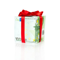euro bill packed as a gift with ribbon and reflection